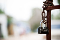 Fence with chain and lock. Background Stock Photo