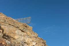 Fence after cliff collapse Stock Image