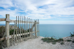 A fence at the cliffs in England. A fence at the cliffs, Seven Sisters country park, England Stock Images
