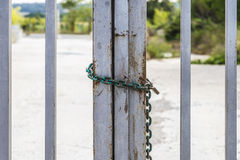 Fence closed with a chain and a padlock Royalty Free Stock Images