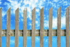 fence with cloudy sky stock image