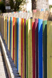 Fence of colourful pencils Stock Photo