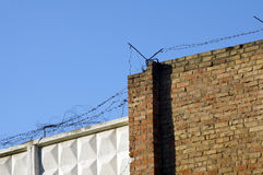 Fence from concrete blocks and a brick. With a barbed wire Royalty Free Stock Image