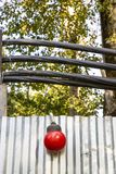 Fence at a construction site with a red lantern. And electrical cables royalty free stock photography