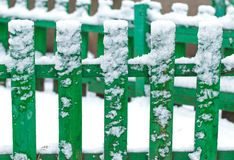 Fence covered by first snow. Stock Photo