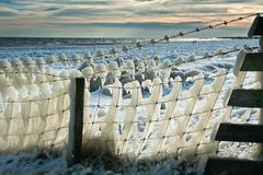 Fence covered in ice Stock Photos
