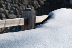 Fence covered by powder snow Stock Photos