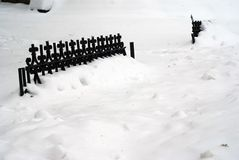 Fence covered in snow Royalty Free Stock Image