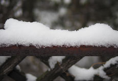 Fence covered with snow Stock Images