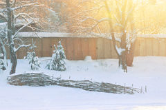 Fence covered by snow Stock Photos