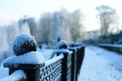 Fence covered snow winter park Royalty Free Stock Photo