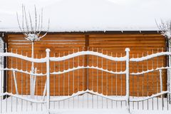 Fence covered with snow. Stock Photo