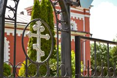 Fence with a cross around the Orthodox Church Royalty Free Stock Image