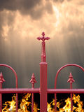 Fence with cross, heaven and hell Stock Photography