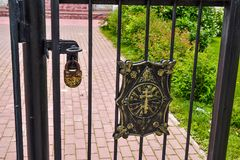 Fence with a cross and a padlock of the Orthodox Church Royalty Free Stock Images
