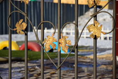 Fence decoration with gilded leaves Stock Image
