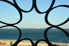 Fence design. Landscape of a city in Sicilia through a fence Stock Image