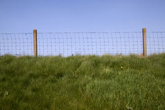 Fence on a dike Royalty Free Stock Images