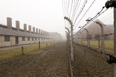 Fence with electrical barbed wire at Auschwitz. Concentration camp in Poland Stock Image