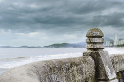 Fence element. Of the waterfront and a dramatic sky Stock Photography