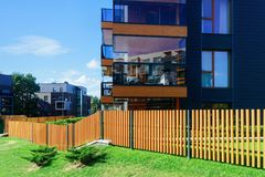 Fence at European architectural complex of apartment residential building. And outdoor facilities stock image