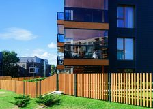 Fence at European architectural complex residential buildings. And outdoor facilities. Fence at European architectural complex of residential buildings. And stock photo