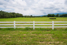 Fence in farm field with cloudy royalty free stock photo