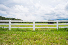 Fence in farm field with cloudy Royalty Free Stock Images