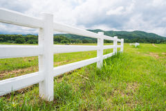 Fence in farm field with cloudy Royalty Free Stock Photos
