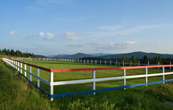 Fence and farm pasture Royalty Free Stock Photo