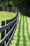 Fence on a field royalty free stock photo