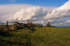 Fence and firmament. Border between sky and earth Stock Photography