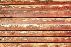 Fence of flat boards. Wooden horizontal slats. Background with a texture of old wood with a cracked paint. Fence of flat boards. Wooden horizontal slats royalty free stock photography