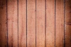 The fence of flat vertical boards. Background with a wooden texture. Photo with a vignette stock images