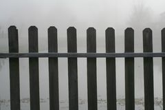 Fence in fog Royalty Free Stock Image