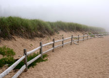 Fence in Fog. Fence on beach in Acadia National Park Royalty Free Stock Images