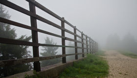 Fence in fog Stock Photos