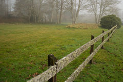 Fence into the fog. Fence line going off into the fog along the Washington coast Royalty Free Stock Image