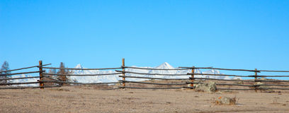 Fence in the foreground Royalty Free Stock Photos