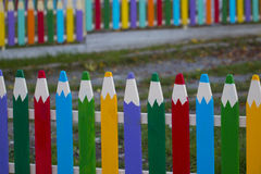Fence in the form of colored pencils Stock Photo