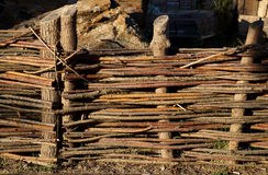 Fence in the form of a rural wattle fence Stock Image