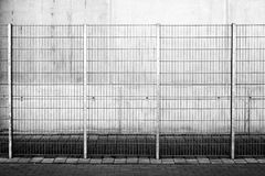 Fence in front of concrete facade Royalty Free Stock Images