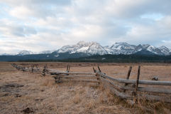 Fence in front of Mountains. Fence in front of the Sawtooth Mountains in Stanley, Idaho Stock Photos