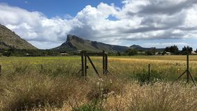 Fence in front of the mountains with a cloudy day. Pollença, Mallorca. royalty free stock image