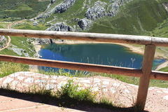 Fence in front of a Saliencia& x27;s lake full of water in Asturias Royalty Free Stock Photo