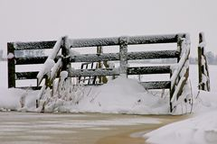 Fence full of snow Stock Images