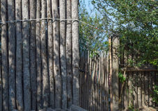 The fence and gate made of logs Stock Photos