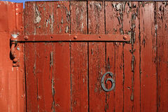 Fence gate with peeling red paint royalty free stock photo