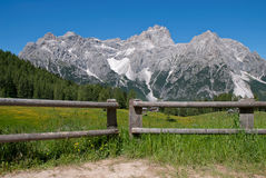 Fence with glacier Stock Images