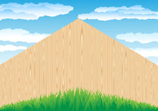 Fence_and_grass. The wood fence and the green grass on blue sky background Royalty Free Stock Photography